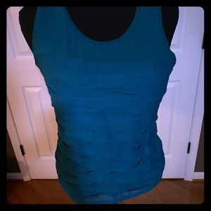 Ann Taylor turquoise shell in size M. Fun ruffles